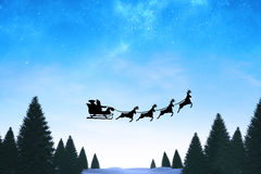 Composite image of silhouette of santa claus and reindeer Royalty Free Stock Photos