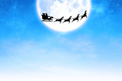 Composite image of silhouette of santa claus and reindeer Stock Images