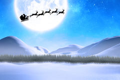 Composite image of silhouette of santa claus and reindeer Royalty Free Stock Image
