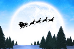 Composite image of silhouette of santa claus and reindeer Royalty Free Stock Photography