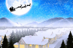 Composite image of silhouette of santa claus and reindeer Royalty Free Stock Images