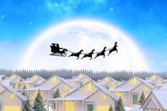 Composite image of silhouette of santa claus and reindeer Royalty Free Stock Photo