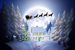 Composite image of silhouette of santa claus and reindeer Stock Photo