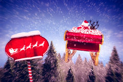 Composite image of silhouette of santa and reindeer Stock Images
