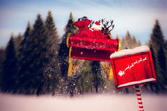 Composite image of silhouette of santa and reindeer Royalty Free Stock Image