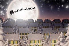 Composite image of silhouette of santa and reindeer Stock Image