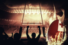Composite image of silhouettes of football supporters Royalty Free Stock Photo
