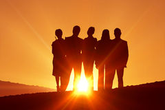 Composite image of silhouettes standing Royalty Free Stock Photo