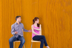 Composite image of sitting couple having an argument Stock Images