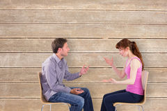 Composite image of sitting couple having an argument Stock Photography
