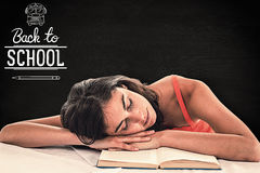 Composite image of sleeping student head on her books Stock Photography