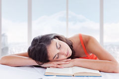 Composite image of sleeping student head on her books Stock Image