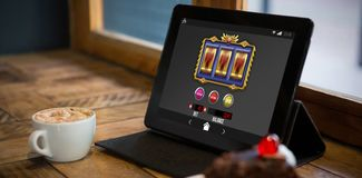Composite image of slot machine on mobile screen Royalty Free Stock Photo