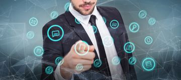 Composite image of smart businessman in suit pointing at camera Royalty Free Stock Photography