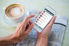 Composite image of smartphone app menu. Smartphone app menu against men using mobile phone by coffee and newspaper in cafe Stock Images