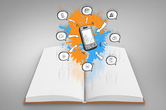 Composite image of smartphone apps on paint splashes on open book Royalty Free Stock Photos