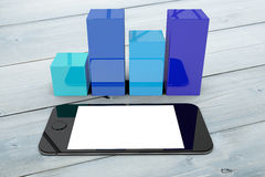 Composite image of smartphone with graphs Royalty Free Stock Image