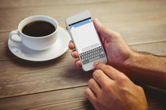 Composite image of smartphone text messaging Royalty Free Stock Photos