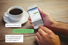 Composite image of smartphone text messaging Royalty Free Stock Photography