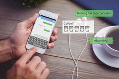 Composite image of smartphone text messaging Royalty Free Stock Photo