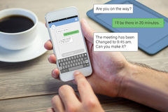 Composite image of smartphone text messaging Stock Photos