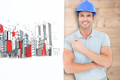 Composite image of smiling architect with bill board over white background Stock Photography