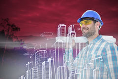 Composite image of smiling architect looking away while holding blueprint Stock Images