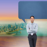 Composite image of smiling asian businessman with speech bubble Royalty Free Stock Photography