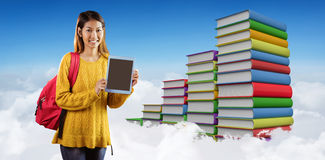 Composite image of smiling asian female student showing tablet Royalty Free Stock Photo