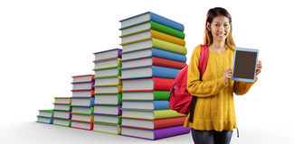 Composite image of smiling asian female student showing tablet Royalty Free Stock Image