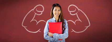 Composite image of smiling asian woman holding red book Stock Images