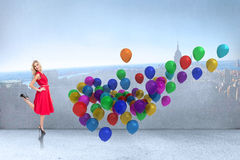 Composite image of smiling blonde standing hands on hips Royalty Free Stock Images