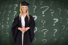 Composite image of smiling blonde student in graduate robe Royalty Free Stock Images