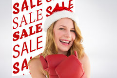 Composite image of smiling blonde wearing red boxing gloves Royalty Free Stock Photo