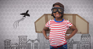 Composite image of smiling boy pretending to be pilot Royalty Free Stock Images
