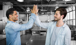 Composite image of smiling boys clapping his hands Royalty Free Stock Photography