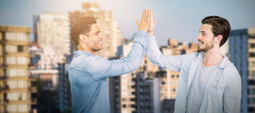 Composite image of smiling boys clapping his hands Stock Image