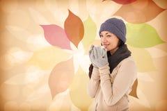 Composite image of smiling brunette drinking hot beverage Stock Photography