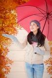 Composite image of smiling brunette feeling the rain Stock Photography