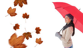 Composite image of smiling brunette holding red umbrella Royalty Free Stock Image