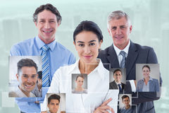 Composite image of smiling business people brainstorming together stock image