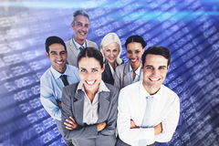 Composite image of smiling business people looking at camera with arms crossed Stock Image