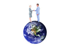 Composite image of  smiling business people shaking hands Royalty Free Stock Image