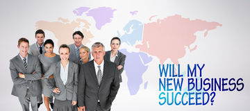 Composite image of smiling business people smiling at camera Royalty Free Stock Photo