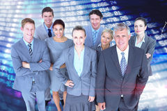 Composite image of smiling business people smiling at camera Royalty Free Stock Images