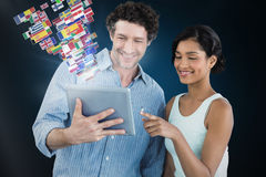 Composite image of smiling business people using digital tablet Stock Photography