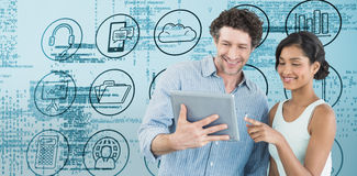 Composite image of smiling business people using digital tablet Royalty Free Stock Image
