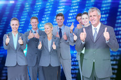 Composite image of smiling business team showing thumbs up Royalty Free Stock Image