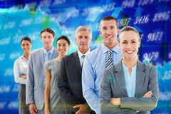 Composite image of smiling business team standing in a line Royalty Free Stock Images