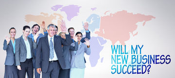 Composite image of smiling business team waving at camera Royalty Free Stock Photos